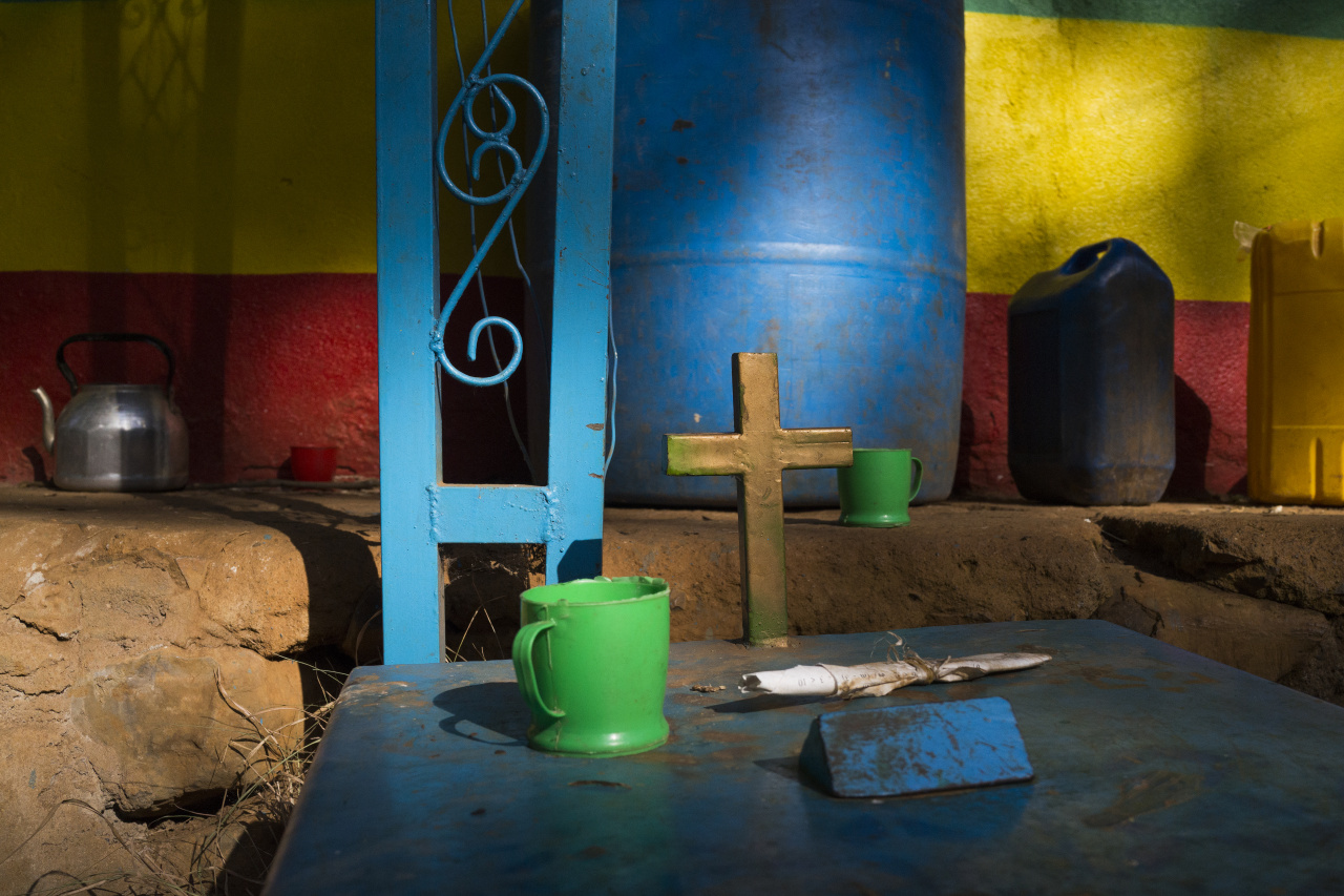 Kieran Dodds World Photography Organisation: Hierotopia Interview A tithe box for beside a brightly-coloured wall at Robit Bahita church.  Church forest land surrounding churches have become islands of biodiversity in seas of agriculture, the last remnants of a once-expansive native cover. Conservation is a key tenet of the Tewahdo Ethiopian Orthodox which has protected them until now when these forests are threatened like never before as agriculture expands to cope with the country's booming population which is due to double over the next 30 years.